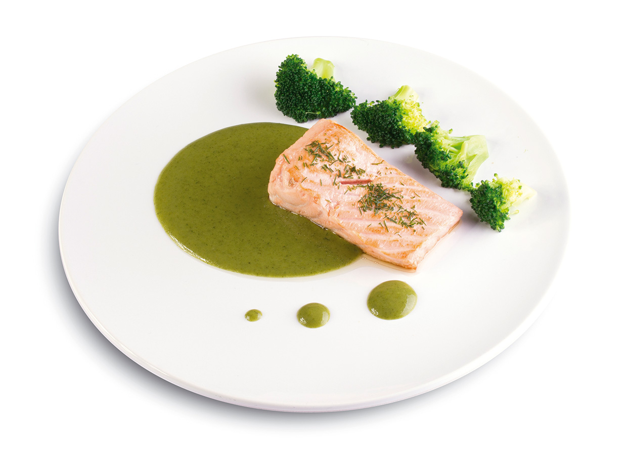 Salmon fillet with al dente broccoli, drizzled with tarragon coulis