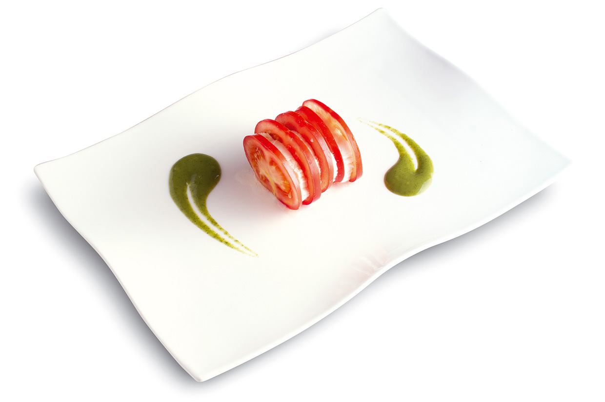 Tomato and Mozzarella salad with Andalusian sprinkle of basil coulisu